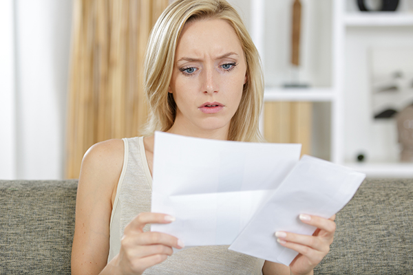 Why is a 'Paid' judgment appearing on my credit report as 'Not Satisfied'?